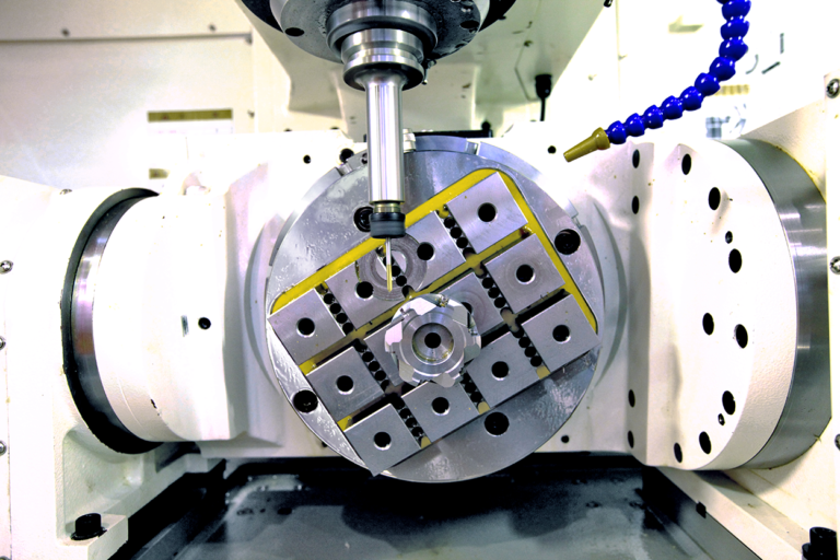 Techniks circular workholding magnet holding metal part in 5-axis cnc center